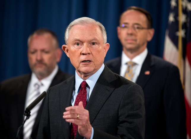epa06098996 US Attorney General Jeff Sessions (C), along with Deputy Attorney General Rod Rosenstein (R), speaks to the media about an international cybercrime enforcement action at the Department of Justice in Washington, DC, USA, 20 July 2017. On 19 July, President Trump said he would not have appointed Sessions if he knew Sessions would recuse himself from the Russia investigation. EPA/JIM LO SCALZO