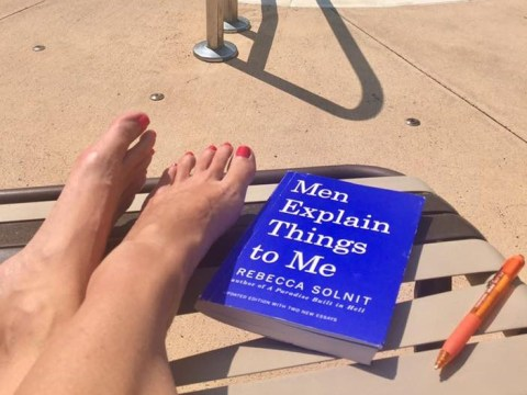 Woman gets mansplained at while reading a book about mansplaining