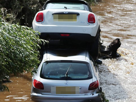 Roads ripped up and dozens rescued after heavy flooding hits Northern Ireland