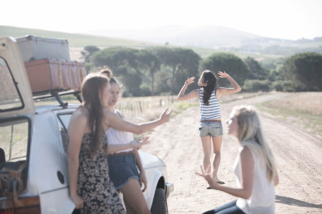 South Africa, Friends on a road trip having a car breakdown
