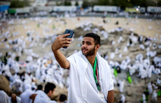 What does Eid Mubarak mean and how should you reply to the greeting