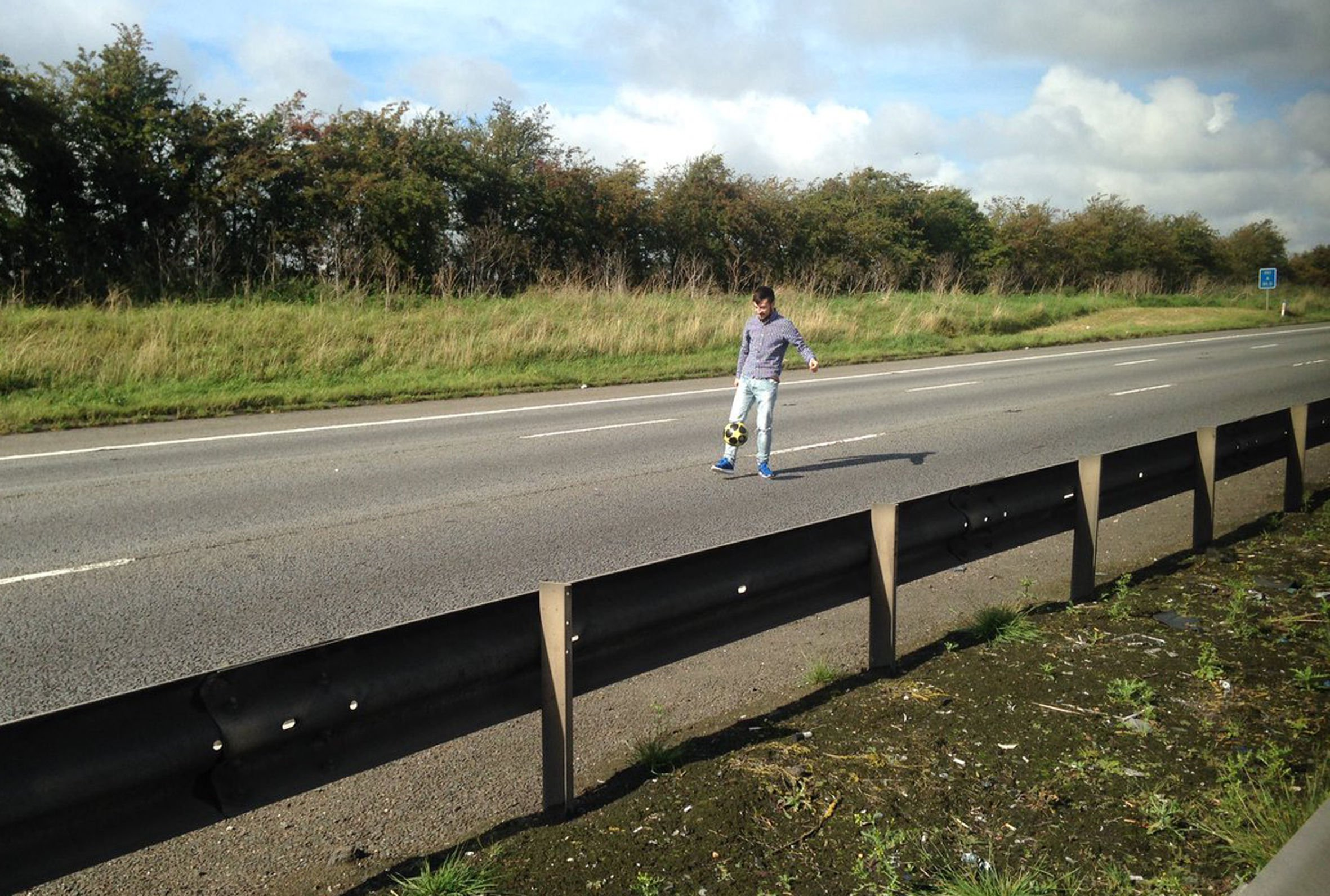 Frustrated drivers play football and frisbee on M1 while stuck in traffic