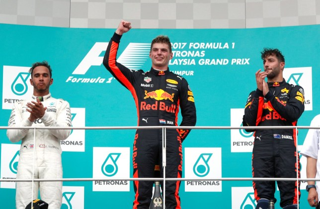 Formula One F1 - Malaysia Grand Prix - Sepang, Malaysia - October 1, 2017. Redbull's Max Verstappen celebrates winning the race between teammate Daniel Ricciardo and Mercedes¿Äô Lewis Hamilton. REUTERS/Edgar Su