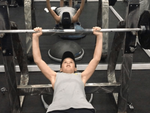 Cruz Beckham, 12, appears to lift weights at the gym as worried fans express concern