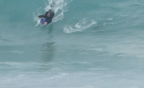 Bodyboarder stalked by four-metre long shark as he catches wave