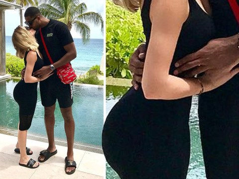 Khloe Kardashian appears to dispel pregnancy rumours with flat stomach Instagram photo