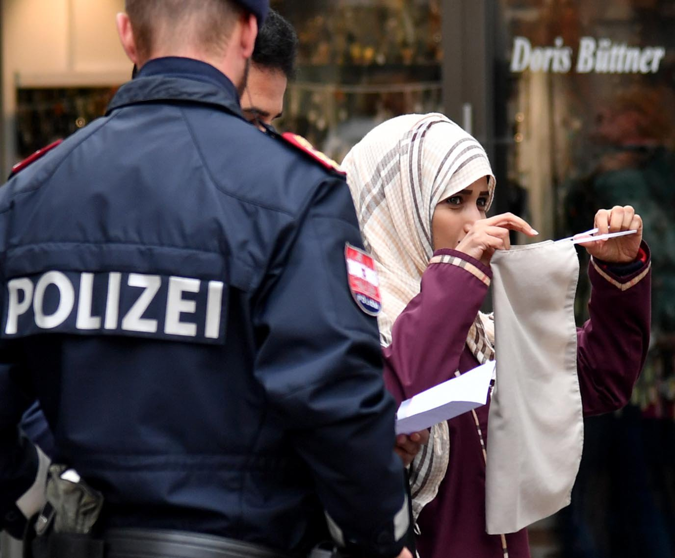 Muslim woman forced to take veil off by armed police in Austria