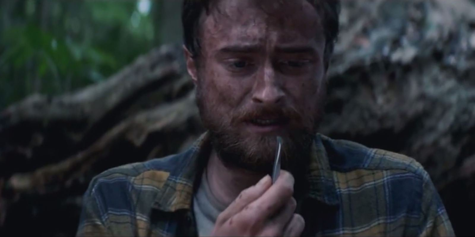 Put down what you're eating and watch Daniel Radcliffe pull a worm out of his head in Jungle