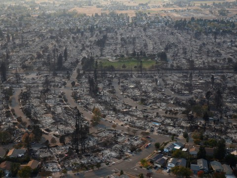 Scale of wildfire devastation seen in shocking aerial photos as death toll rises to 23