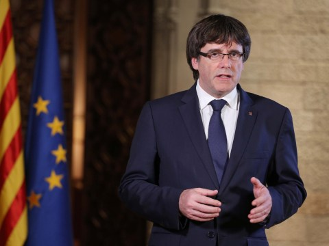 Catalan leader hands himself in to police in Belgium after arrest warrant issued