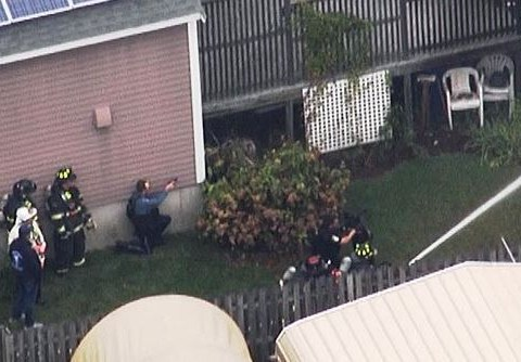 Man barricades himself in burning home as SWAT respond to 'active shooter'