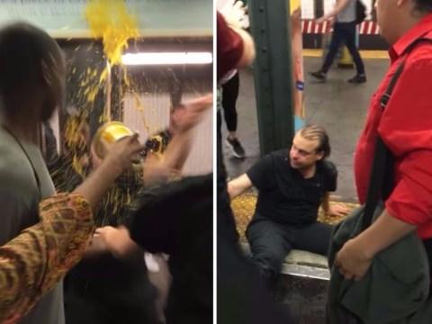 Drunk man shouting N-word on train gets hot soup dumped on head