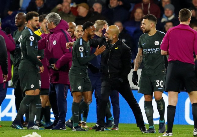 Pep Guardiola goes in for a hug with Raheem Sterling