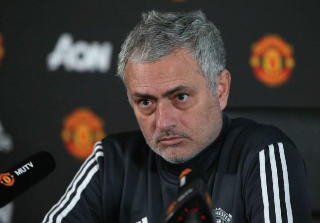 Jose Mourinho listens to a question