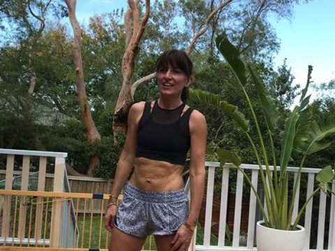 Davina McCall showcases abs that made her fitness DVD queen as she holidays after marriage split