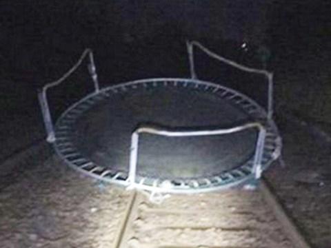 Storm Caroline blows trampoline on train tracks as 90mph winds batter UK