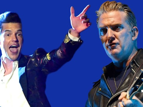 The Killers' Brandon Flowers hugs band's photographer on stage following controversial Josh Homme incident