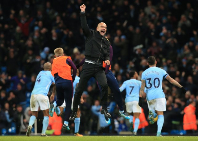 Pep Guardiola leaps into the air