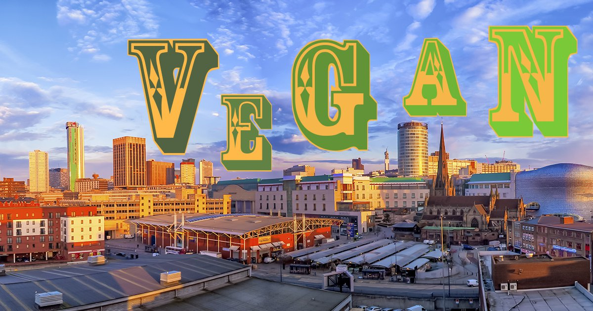A picture of the Birmingham skyline with the word 'vegan' written above it.
