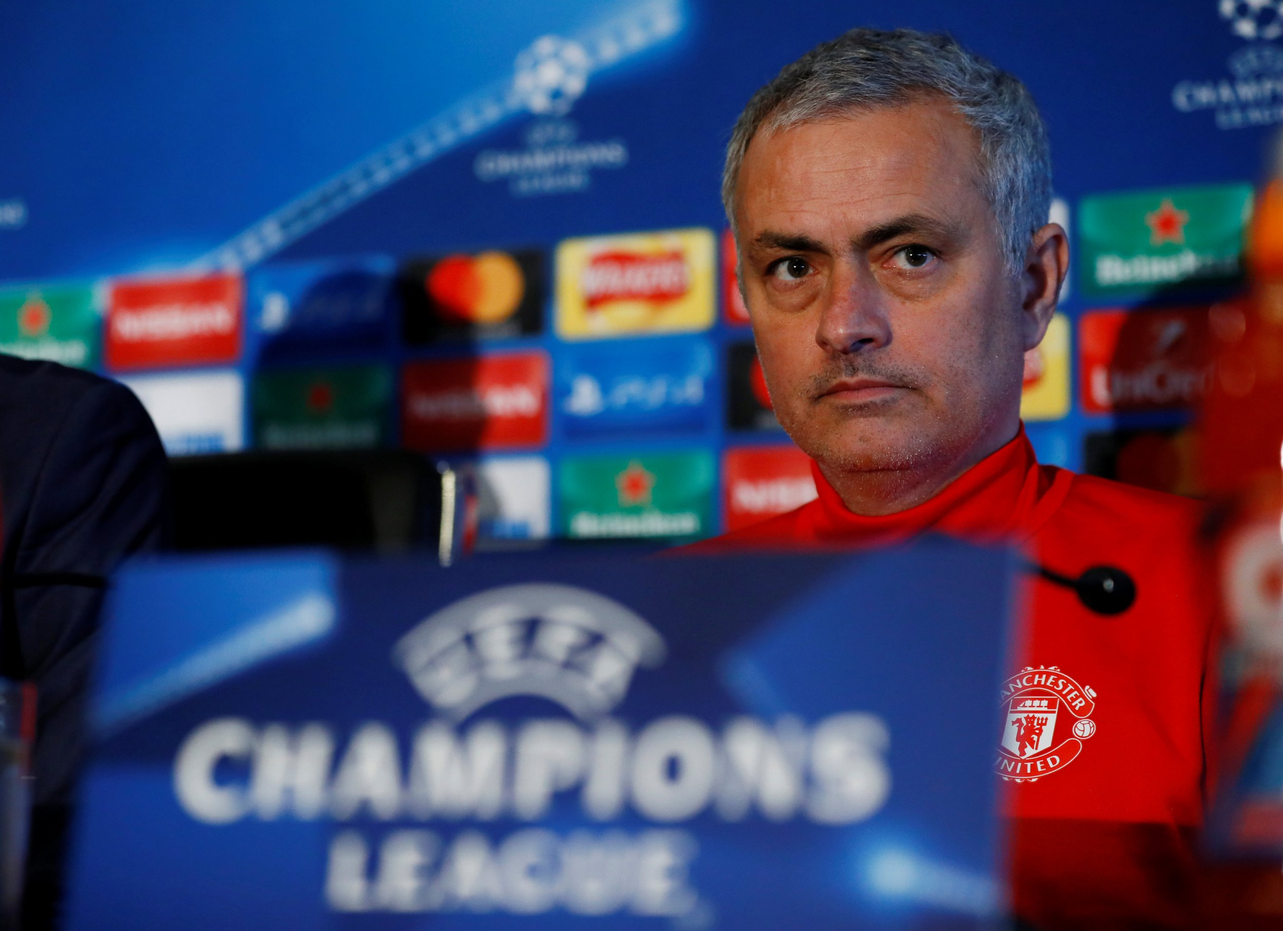 Jose Mourinho looks sullen listening to a question