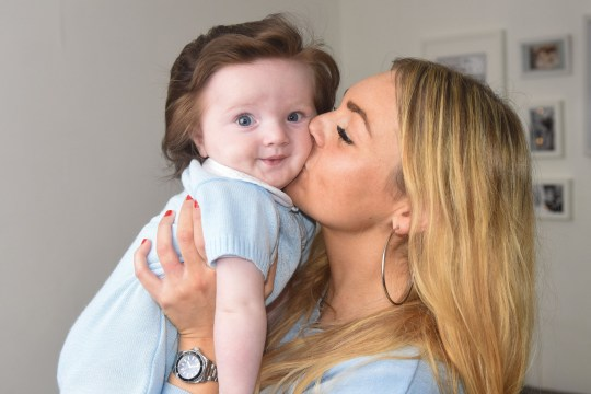 Baby has so much hair his mum has to give him regular blow