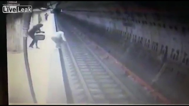 Woman dies after being kicked on to tracks and crushed by