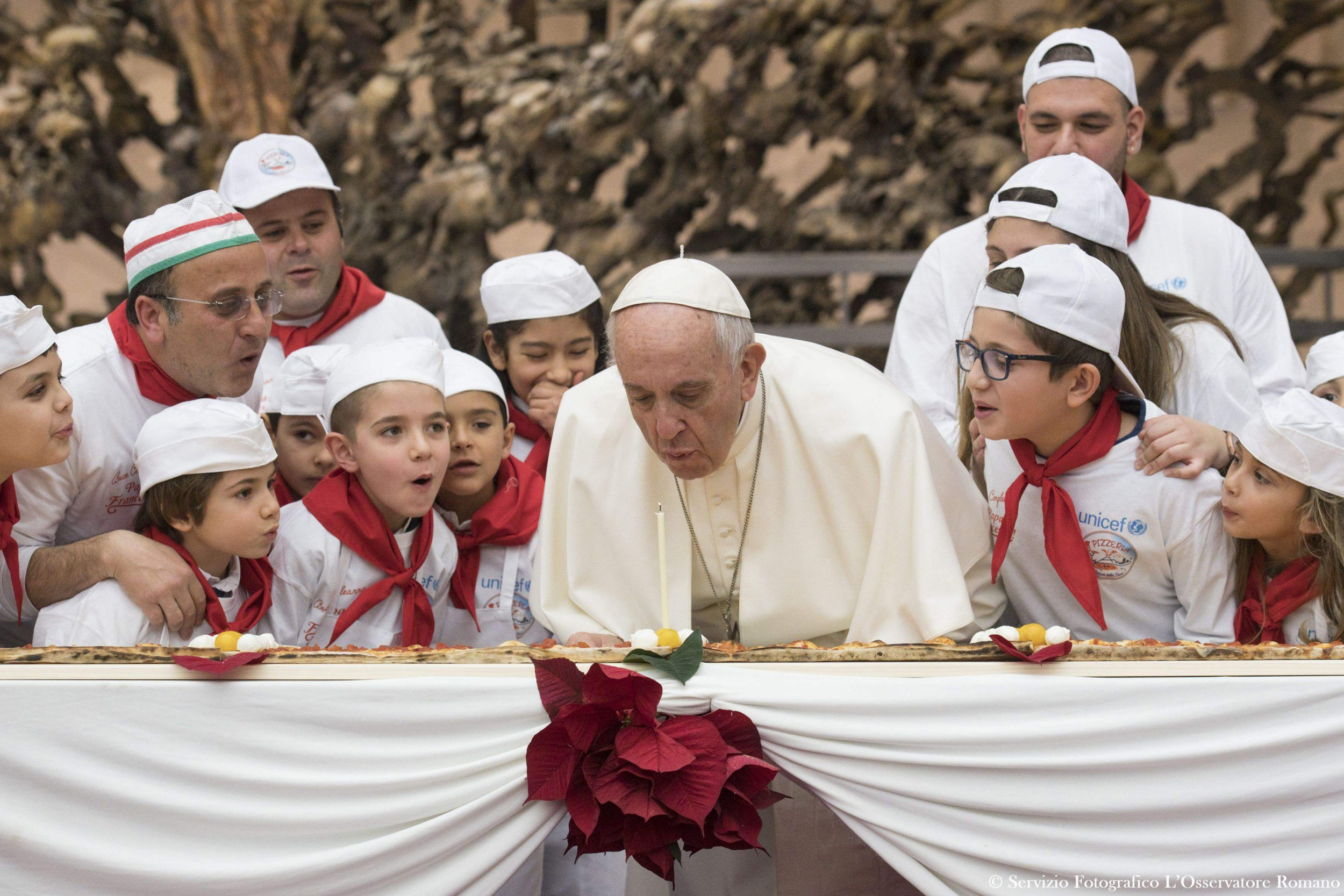 Pope Francis blows out birthday candle on massive pizza