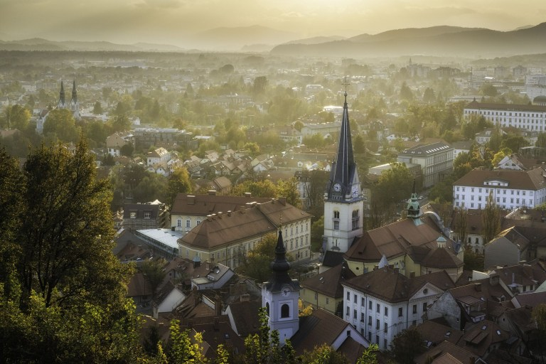 Misty view over Ljubljana from Castle Hill at sunset, Slovenia