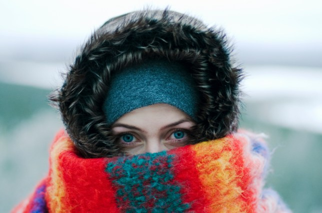 A woman wrapped in a hat and scarf