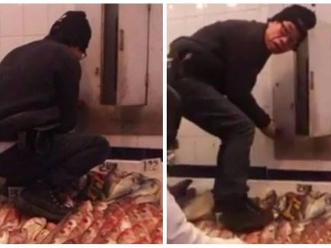 Worker filmed stepping on fish for sale at market