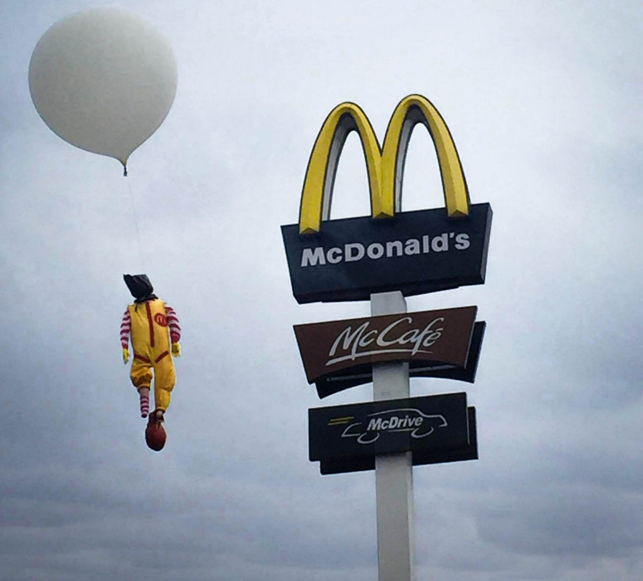 Photographer makes billboards to portray the corporate greed of major brands
