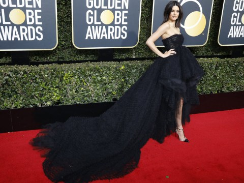 Kendall Jenner sticks to all-black Golden Globes dress code in huge red carpet gown