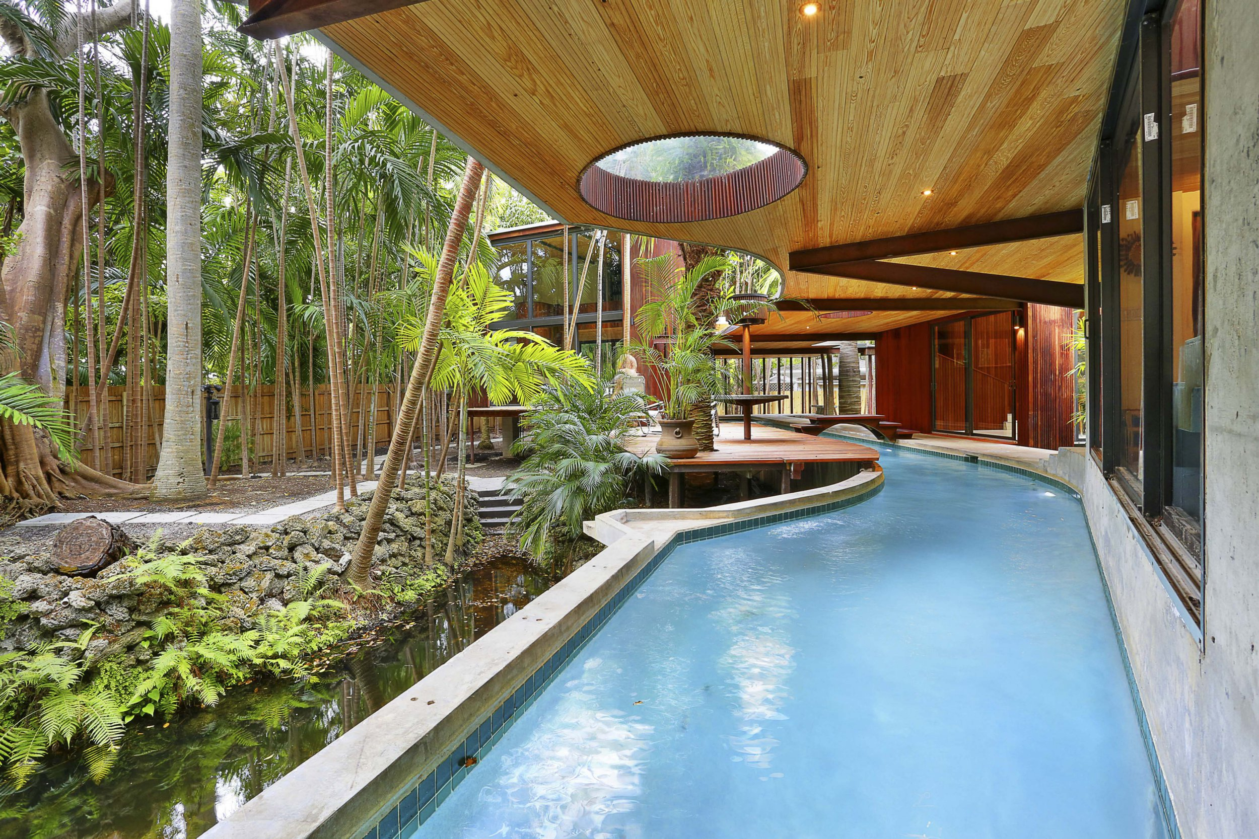 Amazing house has its own river that lets you swim from room to room