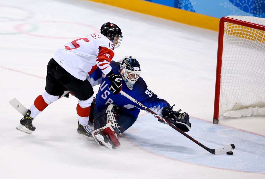 Melodie Daoust and Jocelyne Lamoureux score amazing penalties as USA beat Canada in women's ice hockey final