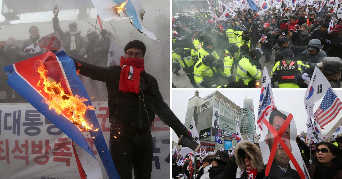 South Korean protesters burn flags and photos of Kim Jong-un