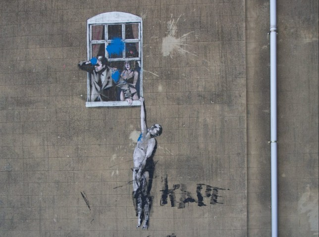 Banksy???s iconic Park Street artwork defaced, Bristol. 25 February 2018. See SWNS story SWBANKSY; Banksy???s iconic Park Street artwork ???Well Hung Lover??? defaced. Vandals painted over the artwork and wrote ???F*** Banksy
