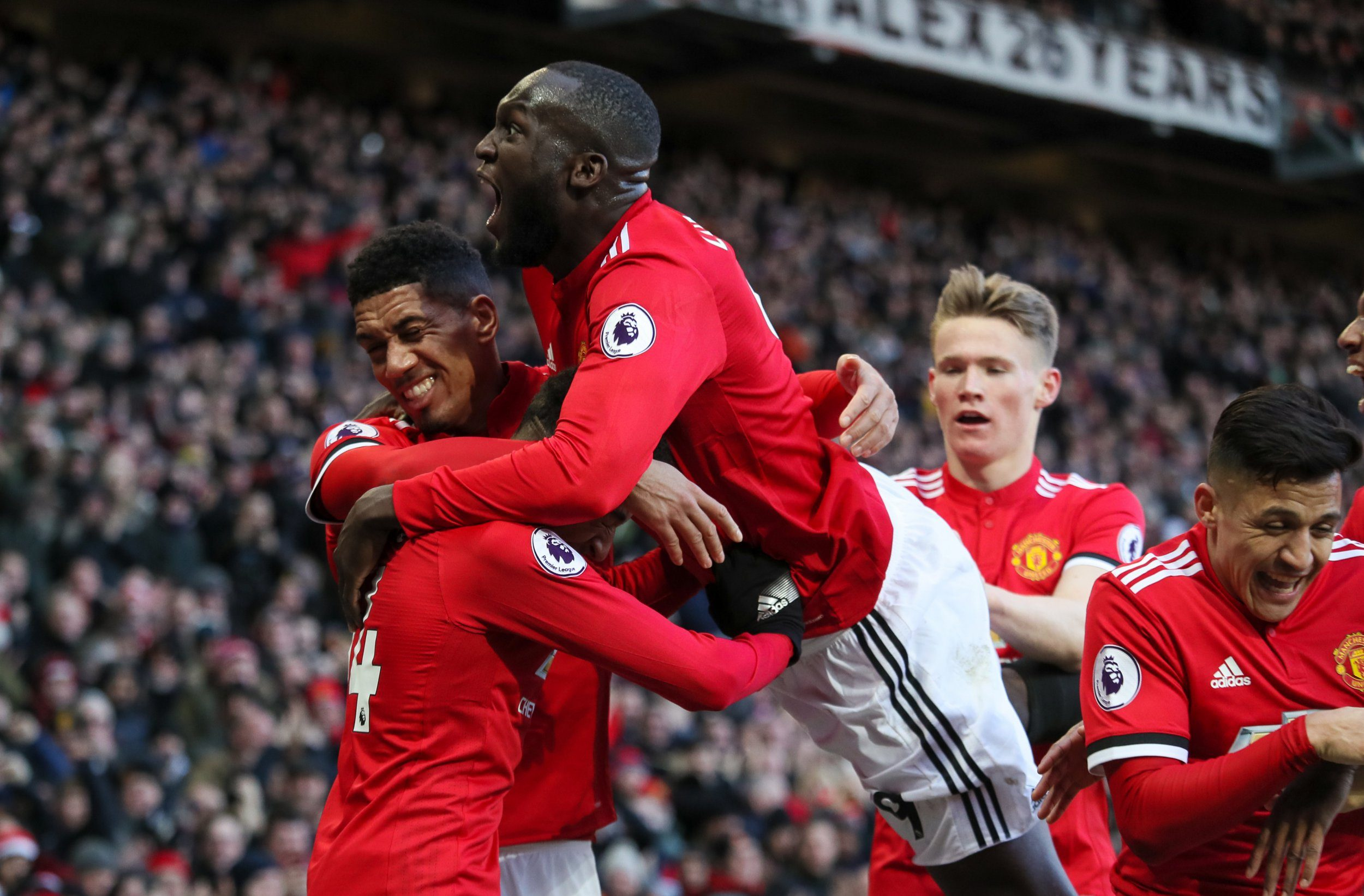 MANCHESTER, ENGLAND - FEBRUARY 25: Jesse Lingard of Manchester United celebrates after scoring a goal to make it 2-1 during the Premier League match between Manchester United and Chelsea at Old Trafford on February 25, 2018 in Manchester, England. (Photo by Matthew Ashton - AMA/Getty Images)