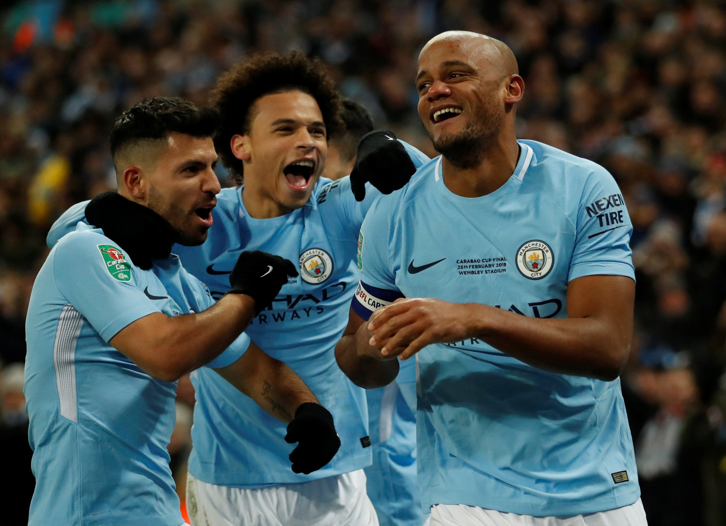 "Soccer Football - Carabao Cup Final - Arsenal vs Manchester City - Wembley Stadium, London, Britain - February 25, 2018 Manchester City's Vincent Kompany celebrates scoring their second goal with Leroy Sane and Sergio Aguero Action Images via Reuters/Carl Recine EDITORIAL USE ONLY. No use with unauthorized audio, video, data, fixture lists, club/league logos or ""live"" services. Online in-match use limited to 75 images, no video emulation. No use in betting, games or single club/league/player publications. Please contact your account representative for further details."