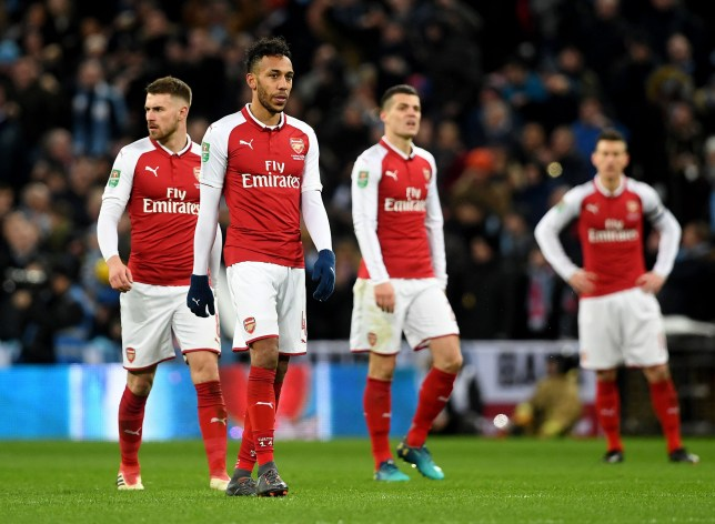 "Arsenal's Pierre-Emerick Aubameyang (second right) and Arsenal's Aaron Ramsey (left) appear dejected after Manchester City's Vincent Kompany (not in picture) scores his side's second goal of the game during the Carabao Cup Final at Wembley Stadium, London. PRESS ASSOCIATION Photo. Picture date: Sunday February 25, 2018. See PA story SOCCER Final. Photo credit should read: Joe Giddens/PA Wire. RESTRICTIONS: EDITORIAL USE ONLY No use with unauthorised audio, video, data, fixture lists, club/league logos or ""live"" services. Online in-match use limited to 75 images, no video emulation. No use in betting, games or single club/league/player publications."