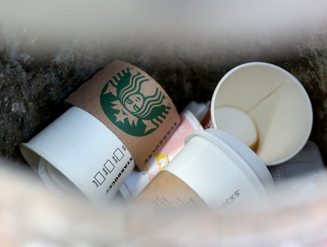 Starbucks cups in a bin in Duisburg, Germany, 19 April 2017. Customers can save 30 cents on their hot beverages if they bring their own cups. Photo: Roland Weihrauch/dpa