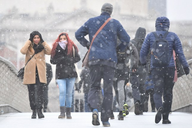 Commuters cross Millennium Bridge in London in the snow as some parts of the UK are set to feel colder than the Arctic Circle as freezing temperatures continue into the week ahead. PRESS ASSOCIATION Photo. Picture date: Monday February 26, 2018. See PA story WEATHER Cold. Photo credit should read: Victoria Jones/PA Wire