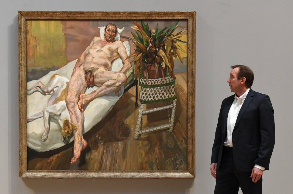 epa06566034 Lucian Freud's assistant, David Dawson with Freud's painting of him titled 'David & Eli (2003-4) during the 'All Too Human' exhibit at the Tate Britain in London, Britain, 26 February 2018. All Too Human celebrates the painters in Britain who strove to represent human figures, their relationships and surroundings in the most intimate of ways. EPA/ANDY RAIN