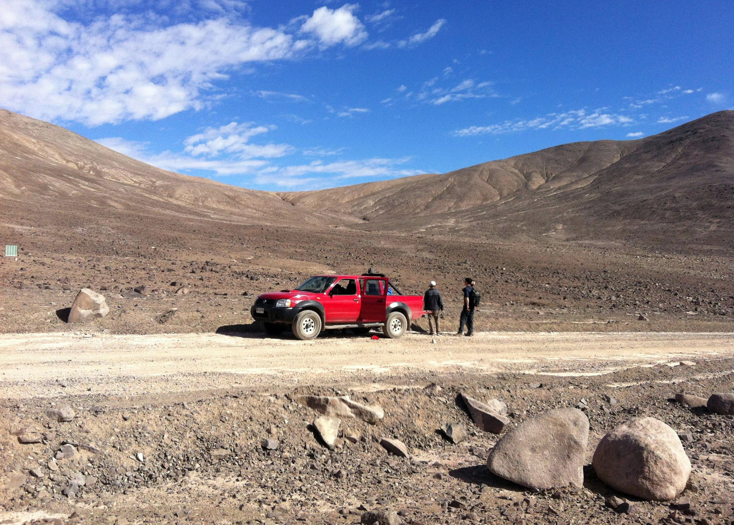 Embargoed to 2000 Monday February 26 Undated Washington State University handout photo of scientists who have driven out into the Atacama desert, in south America, in search of life. PRESS ASSOCIATION Photo. Issue date: Monday February 26, 2018. A freak shower in the world's driest desert has surprised scientists by waking up sleeping microbes - and at the same time increased the chances of finding life on Mars. The US team discovered incredibly hardy bacteria that can lie dormant in the soil for decades without a hint of water. When it unexpectedly rained in their habitat, the most arid corner of South America's Atacama desert, they bounced back into life. See PA story SCIENCE Life. Photo credit should read: Dirk Schulze-Makuch/Washington State University/PA Wire NOTE TO EDITORS: This handout photo may only be used in for editorial reporting purposes for the contemporaneous illustration of events, things or the people in the image or facts mentioned in the caption. Reuse of the picture may require further permission from the copyright holder.