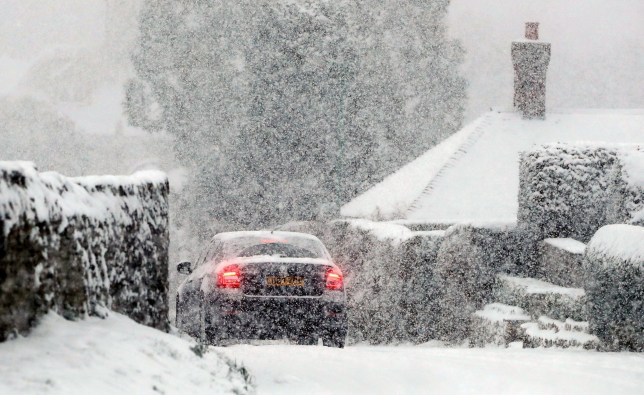 A car travels through snow in Ashford, Kent, which has caused disruption across Britain. PRESS ASSOCIATION Photo. Picture date: Tuesday February 27, 2018. Roads across the UK have already seen a blanketing of snow, with police forces reporting treacherous driving conditions and blocked routes. See PA story WEATHER Snow. Photo credit should read: Gareth Fuller/PA Wire