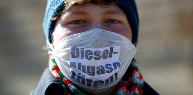 """An environmental activist protests in front of Germany's federal administrative court, before they decide whether German law provides a legal basis for cities to ban diesel cars to help reduce air pollution, in Leipzig, Germany, February 27, 2018. The words read """"Diesel exhaust kills."""" REUTERS/Fabrizio Bensch TPX IMAGES OF THE DAY"""