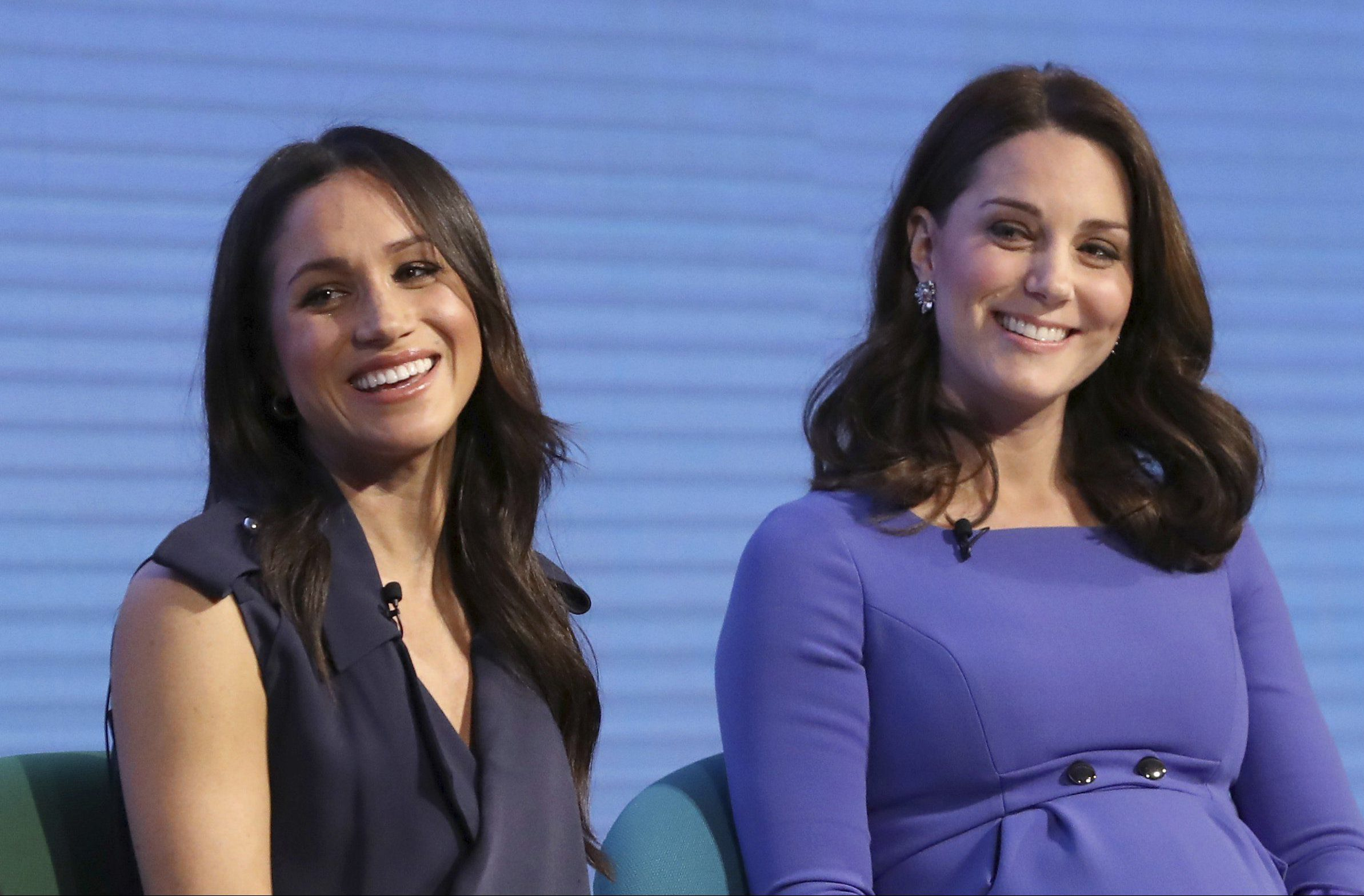 Britain's Kate, Duchess of Cambridge, right, and Meghan Markle attend the first annual Royal Foundation Forum in London, Wednesday Feb. 28, 2018. Under the theme 'Making a Difference Together', the event will showcase the programmes run or initiated by The Royal Foundation. (Chris Jackson/Pool via AP)
