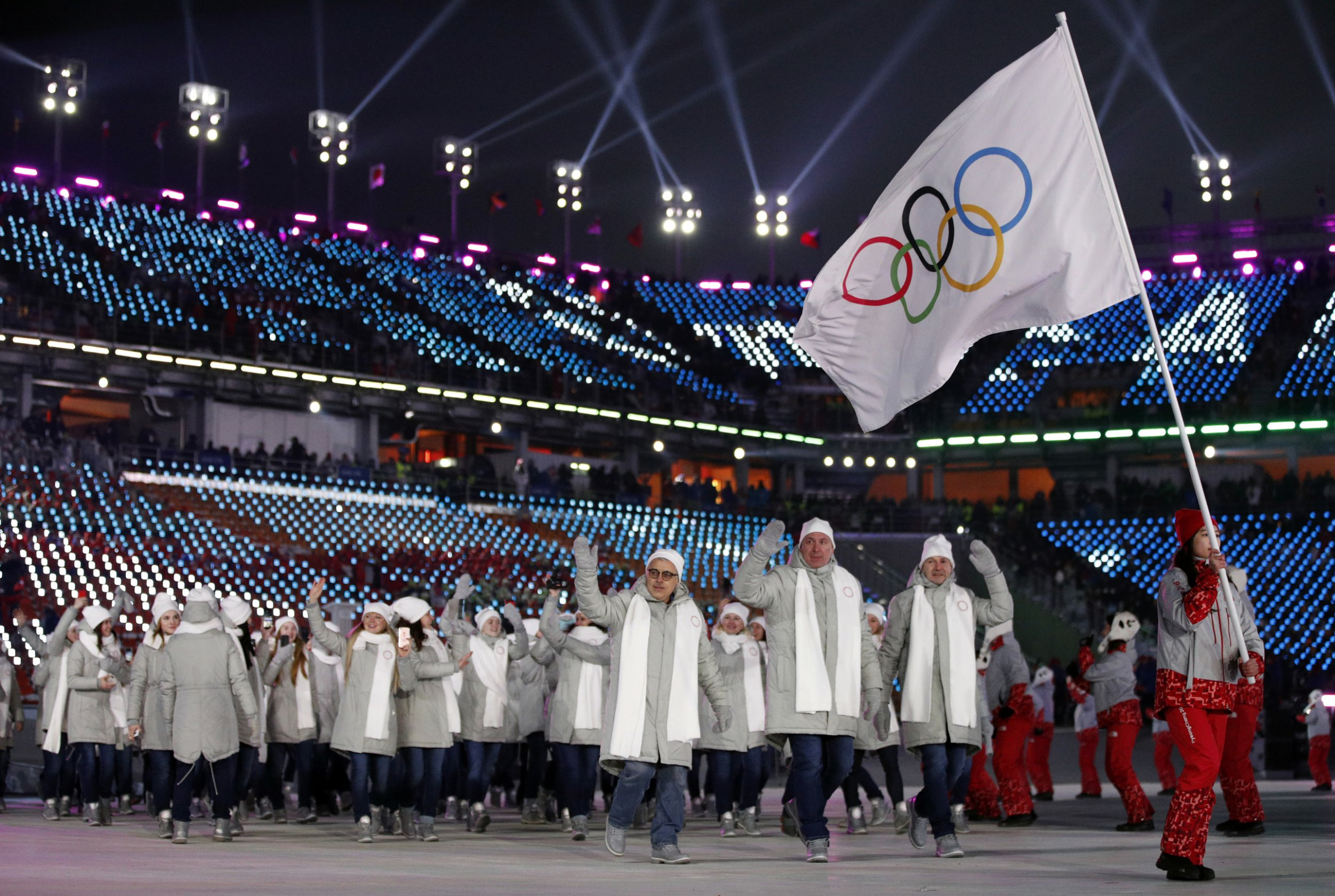 FILE - In this Friday, Feb. 9, 2018 file photo, athletes from Russia wave during the opening ceremony of the 2018 Winter Olympics in Pyeongchang, South Korea. Russia says the IOC has reinstated the country to the Olympic movement despite two failed doping tests by its athletes at the Pyeongchang Winter Olympics. In quotes carried by the TASS news agency, Russian Olympic Committee President Alexander Zhukov said a letter had been received earlier Wednesday, Feb. 28, 2018 from the IOC announcing the nation's reinstatement. (AP Photo/Jae C. Hong, file)