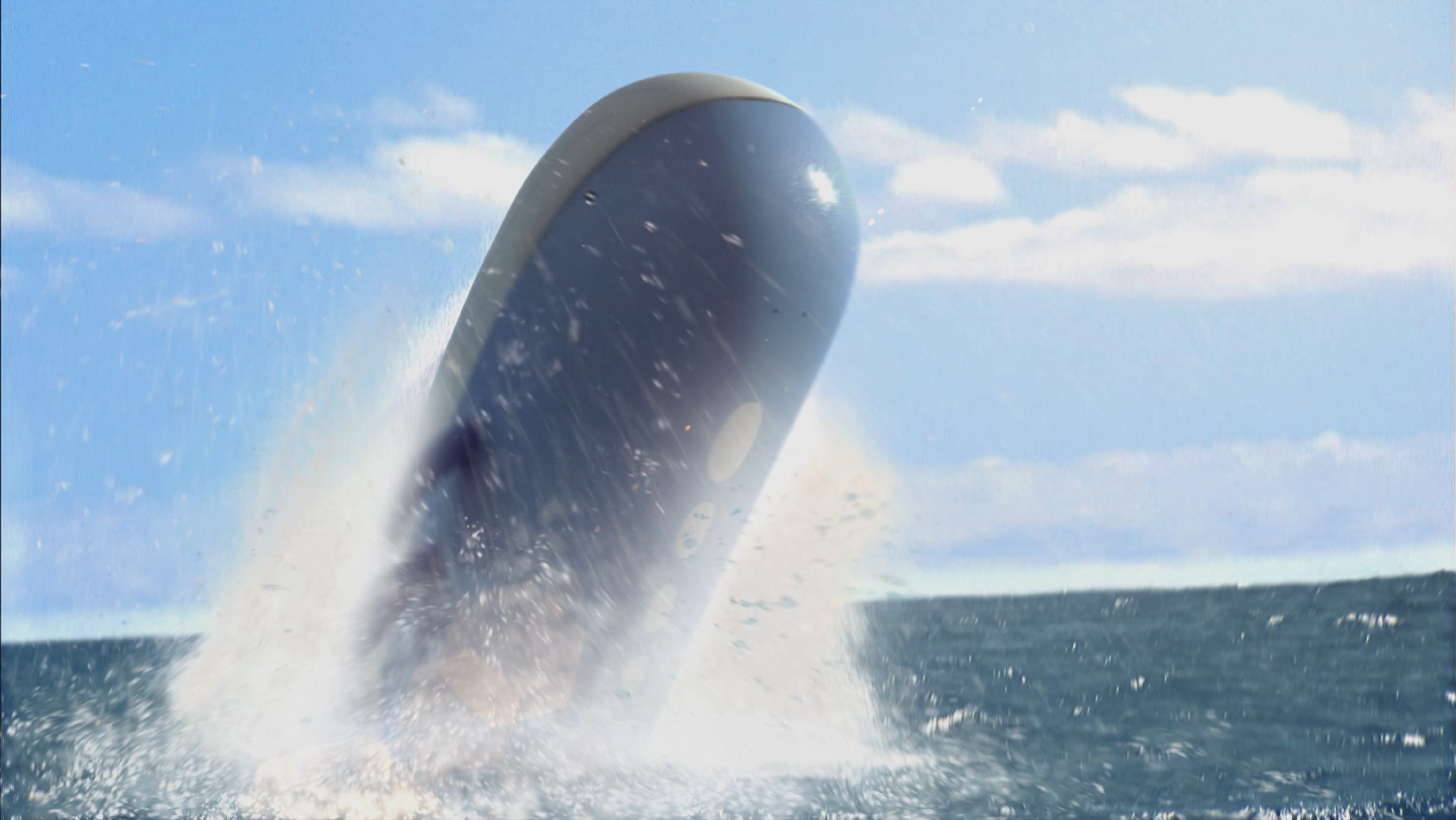 The majestic Wailord leaps above the waves