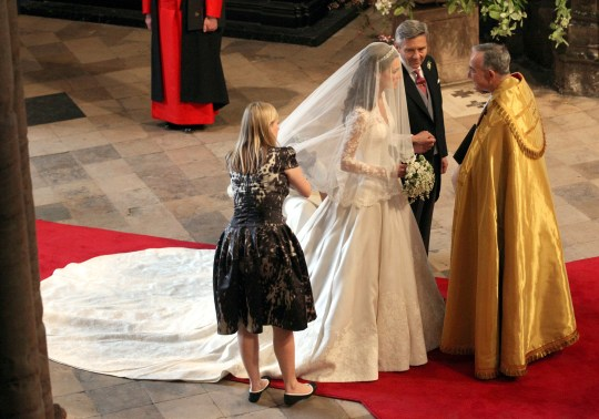 8d548bb9d14 Sarah Burton arranges Kate s dress just before she walked down the aisle  (Picture  Jon Bond – WPA Pool Getty Images)