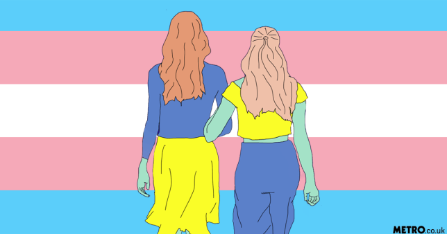 Two women march in front of a trans flag